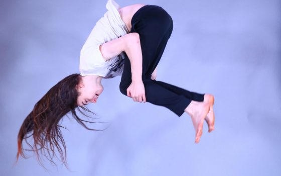 Girl performing a summersault.