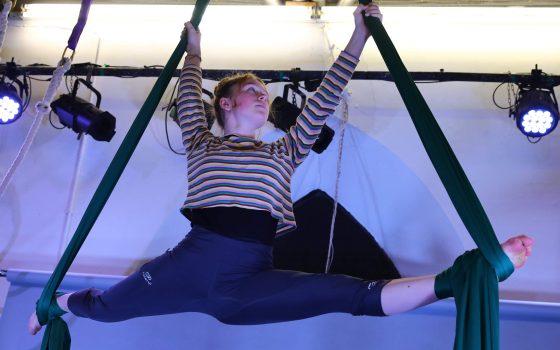 Girl performing splits on the aerial silks