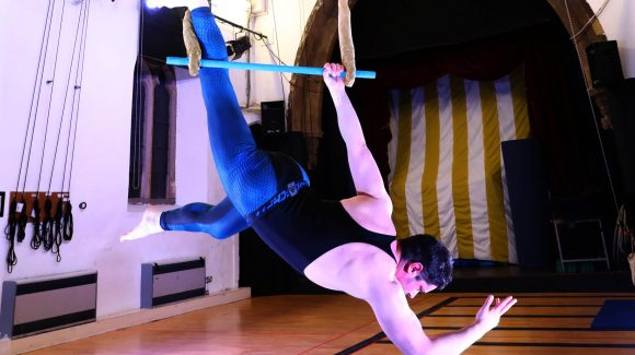 Man hanging from the trapeze